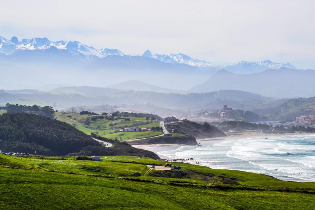Landscape near Oyambre Beach, in San Vicente de la Barquera, Cantabria, Spain. At the bottom, the Picos de Europa Mountains