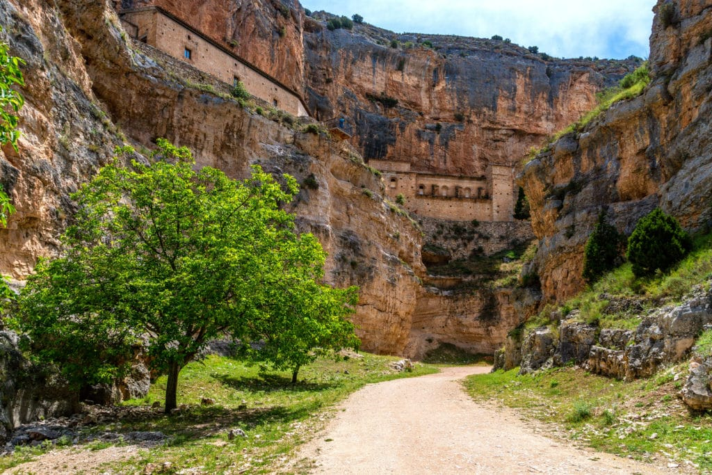 The Our Lady of Jaraba Sanctuary in the Barranco de la Hoz Seca canyon (Dry Defile Gully) in the Aragon region, Spain, during a sunny summer day