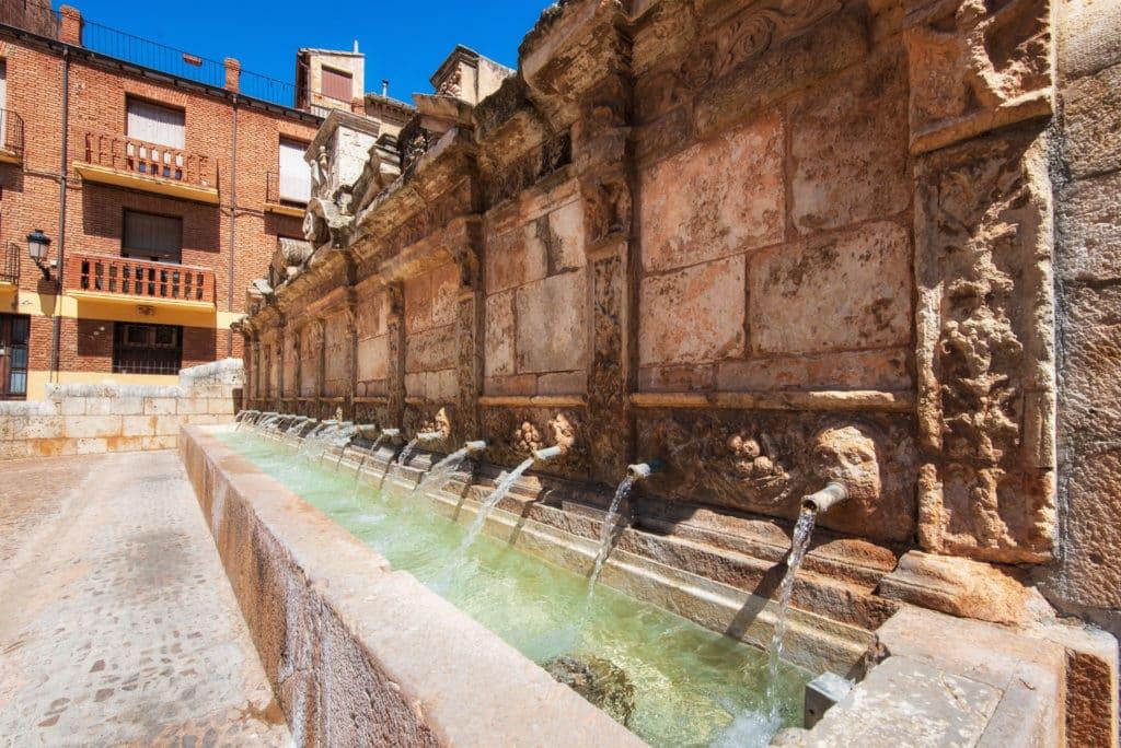Twenty pipes fountain in Daroca village province of Zaragoza, Spain .